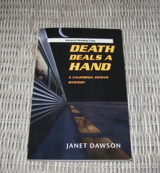 Death Deals a Hand by Janet Dawson.