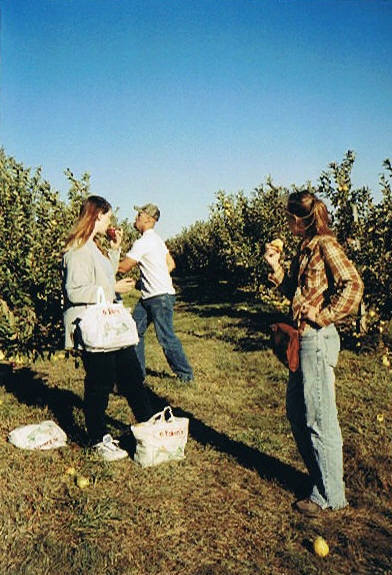Me (surrounded by bags of apples) with friends, 2003.